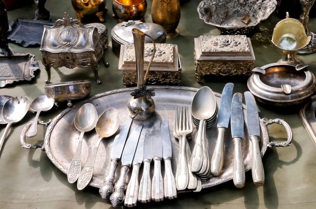 antique silver place settings at estate sale