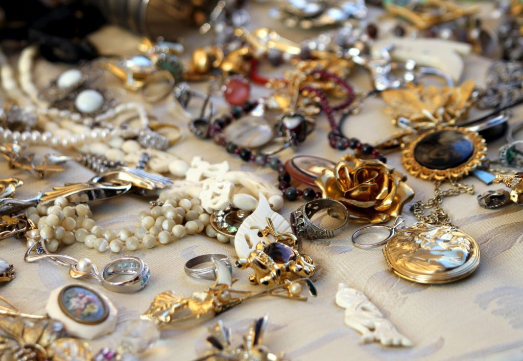 assorted vintage costume and collectible jewelry at estate sale