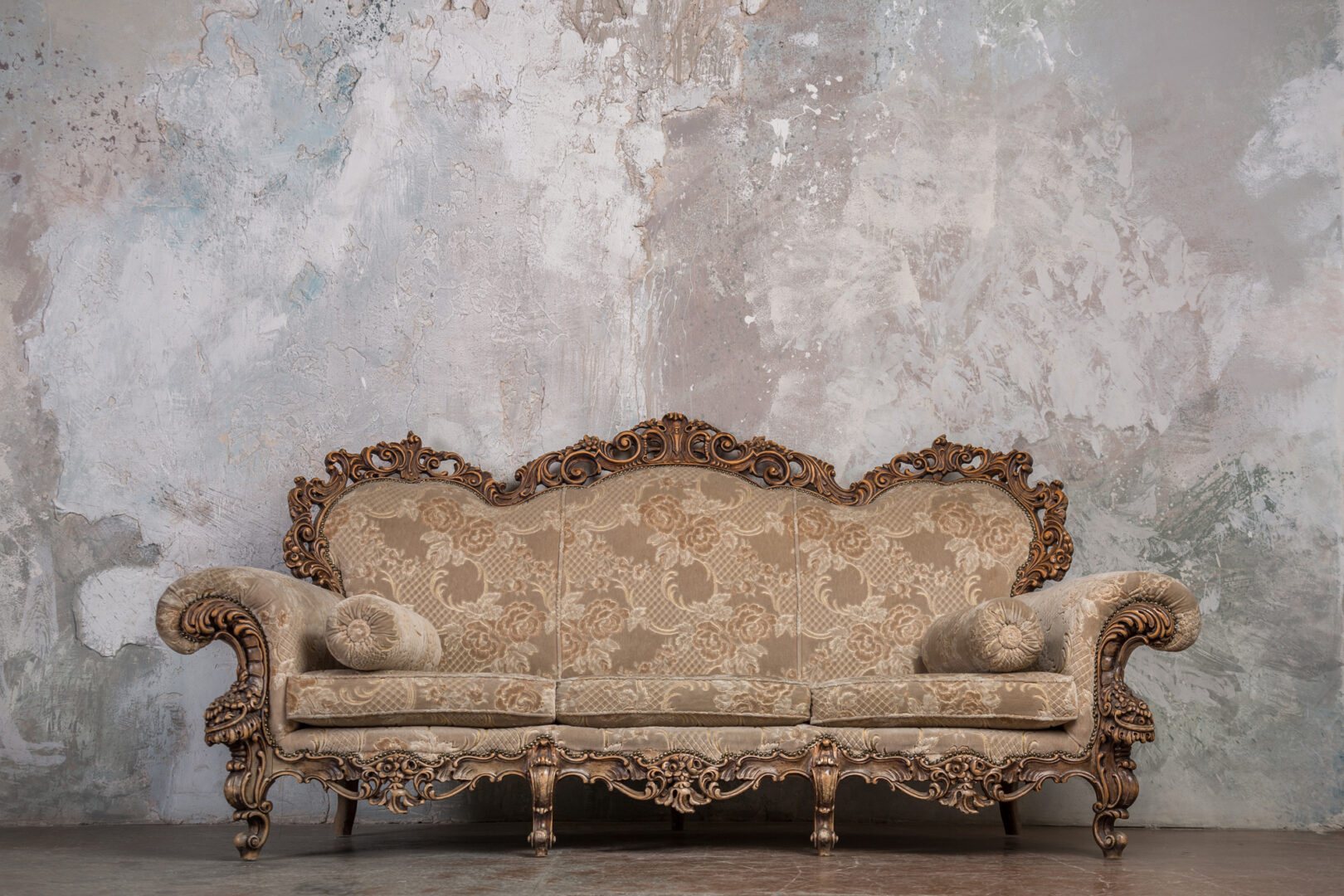 estate sale vintage sofa with brown floral pattern