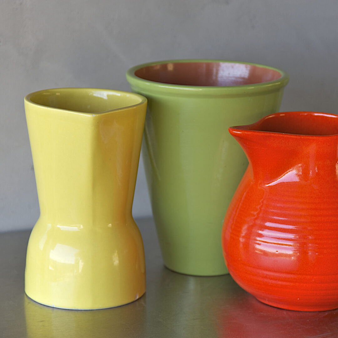 yellow, lime green and cherry red mid-century modern pottery at estate sale