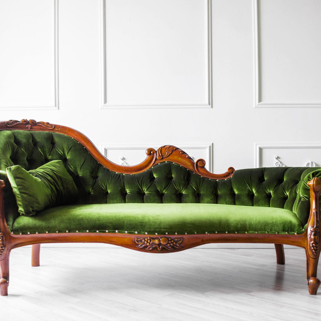 tufted green velvet fainting couch at estate sale